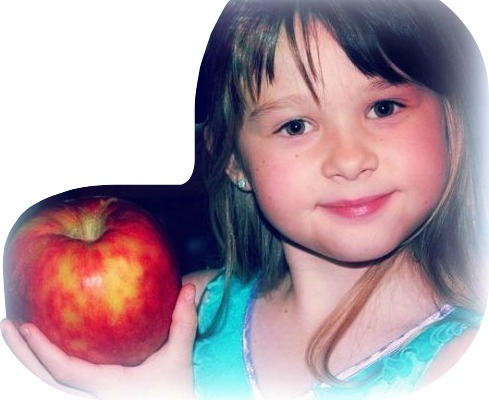 A happy child with her apple